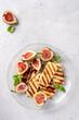 Leinwandbild Motiv Grilled Halloumi Cheese, fresh figs fruit, almonds and honey
