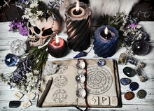 Grunge Still Life With Open Witch Book, Crystal, Flowers, Burning Candles On Altar Table.
