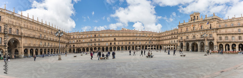 Panoramic view at the baroque public plaza, 18th century, Plaza Mayor in Salamanca downtown city, tourist people visiting