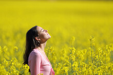 Relaxed Woman Breathing In A Yellow Field In Spring