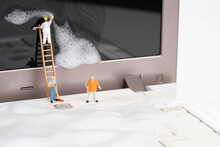 Miniature People Cleaning Up The Computer