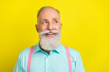Photo Of Cunning Beard Aged Man Look Empty Space Wear Blue Shirt Isolated On Vivid Yellow Color Background
