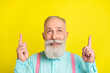 Leinwandbild Motiv Photo of beaming old man point look up wear blue shirt isolated on vivid yellow color background
