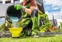 Garden Worker Preparing Grass Fertilizer