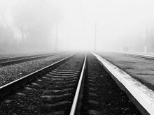 Railroad Tracks In Fog