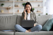 Relaxed asian woman looking for job opportunities online