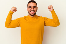 Young Caucasian Man Isolated On White Background Showing Strength Gesture With Arms, Symbol Of Feminine Power