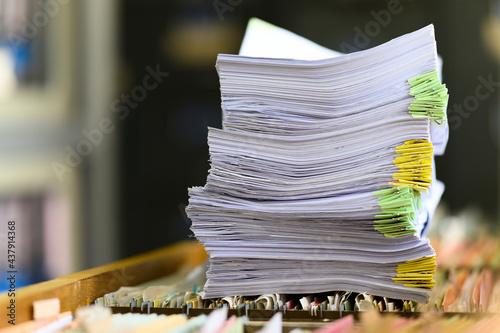 Slika na platnu Close up of stack documents file at office