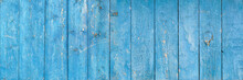 Wooden Background. Old Blue Shabby Wood Planks. A Tattered Dilapidated Fence. Natural Creative Texture For Editing And Design.