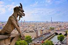 Notre Dame Gargoyle Overlooking The Paris Cityscape With Siene River And Eiffel Tower