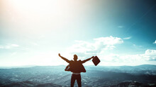 Silhouette Of Successful Businessman Keeping Hands Up Hiking On The Top Of Mountain - Celebrating Success, Winner And Leader Concept