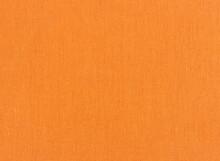 Closeup Of Orange Textile. Fabric Details Backdrop