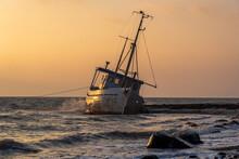 Stranded Fishing Boat At Sunrise