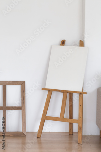 Fotografie, Obraz Wooden empty easel in the room interior.
