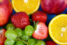 Pile Of Various Fresh Fruits Close-up Stock Images. Grapes, Strawberries, Oranges, Apples Full Frame Background Stock Photo. Mixed Many Type Of Juicy Fruits Images