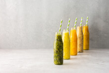 Fruit Smoothies In Jars With Straws, Pineapple And Kiwi, Banana And Mango And Orange Smoothies