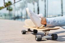 Male Skateboarder In Park In Sunlight
