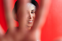 Content Woman Showing Stop Gesture On Red Background