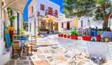 Fototapeta Uliczki - Beautiful Lefkes traditional greek village in Paros island. Charming coffe bars and taverns in colorful narrow streets. Cyclades , Greece