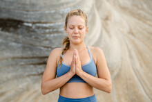 Concentrated Woman Meditating With Praying Hands Outdoors