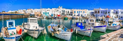 Greece travel. Cyclades, Paros island. Charming fishing village Naoussa. view of old port with  boats and street taverns by the sea. may 2021
