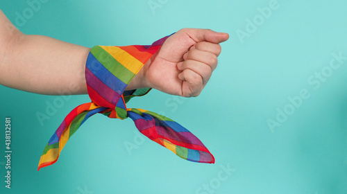 Tela Hand with rainbow handkerchief on mint background or tiffany blue background