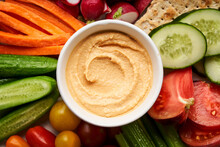 Bowl Of Hummus With Assorted Veggies Served On Plate