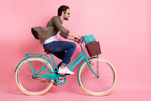 Full Length Body Size Profile Side View Of Attractive Cheerful Guy Riding Bike Isolated Over Pink Pastel Color Background