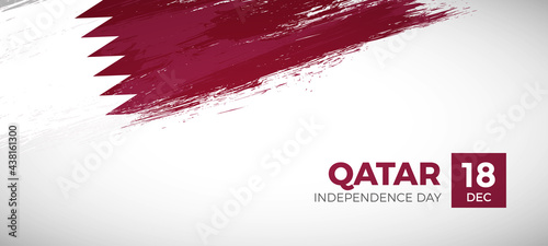 Fotografiet Happy independence day of Qatar with brush painted grunge flag background