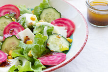 Salad With Cucumber And Beet Slices With Green Leaves