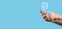 Male Hand Holding Protect Shield With A Check Mark Icon On Blue Background. Protection Network Security Computer And Safe Your Data Concept .