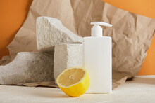 White Plastic Bottle With A Dispenser For Soap Ioi Cream, Lemon And Concrete Podiums, Brown Background, Crumpled Paper, Mock Up Cosmetics Copy Space Blank Bottle