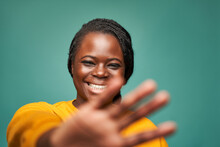 Content Black Woman Showing Stop Gesture With Hand In Daytime In Studio