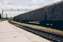 Railway Track And Station With Old Rusty Carriage Freight Train For Delivery