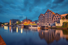 Bydgoszcz, Poland. View Of Old Half-timbered Buildings On Embankment Of Brda River At Dusk