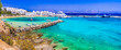 canvas print picture - Greece holidays, Cyclades, Paros island beaches and sea. Scenic tranquil coastal village Piso Livadi with turquoise sea