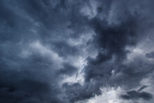 The Dark Sky Had Clouds Gathered To The Right And A Strong Storm Before It Rained.