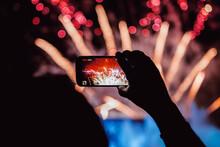 Crop Spectator Recording Video Of Firework On Smartphone