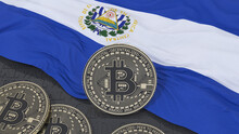 3d Rendering Of A Metallic Bitcoin Over An Salvadoran Flag