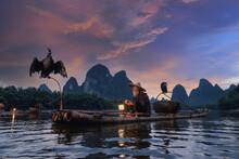Cormorant Fisherman On The Li River, Guilin, Yangshuo, China