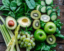Overhead View Of Fresh Green Fruit And Vegetables On A Wooden Table