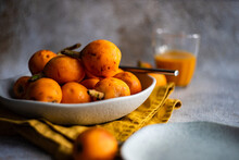 Bowl Of Loquat Fruits And Fruit Juice
