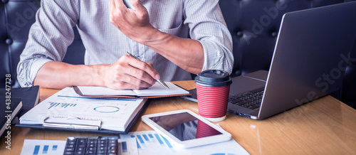 Tela Businessman accountant working audit and calculating expense financial annual fi