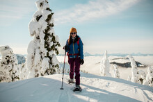 Person Snowshoeing On Pot Of A Mountain