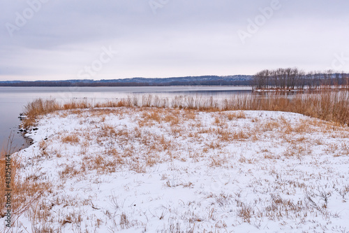 Snowy Shores on the Great River #438254164