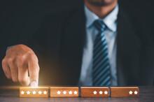 Businessman Choose Five-star Wooden Blocks. Satisfaction Survey Concept. Referral And Customer Service.