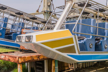Closeup Of Seats Of Broken Abandoned Carnival Ride