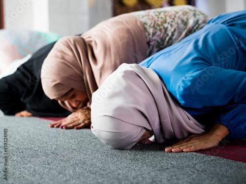 Fototapeta Muslim praying in Sujud posture