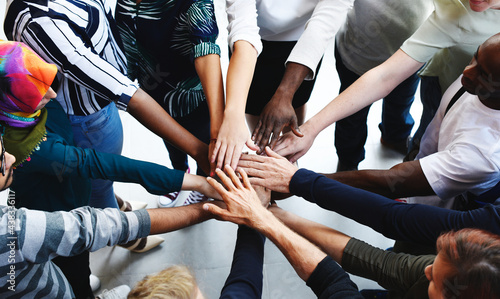 Fotografie, Obraz Diversity teamwork with joined hands