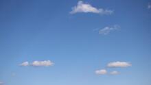 Few Little Fluffy White Clouds In Blue Sky In June